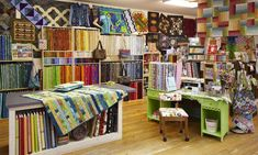 Country Fabrics and Quilting in Brainerd, Minnesota, boasts more than 850 shop samples. Owner Deb Burton and her daughter, Steffani, make three new quilts a week to update their ever-rotating display. Always trying to keep the store fresh, Deb quickly puts fabric that isn't selling well on the sale rack to make room for a new product.