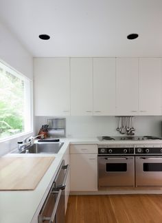 "The ""Meier white"" extends even to the kitchen, which has been updated with new appliances."