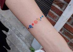 Solar system tattoo on the left inner forearm.