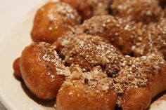 Loukoumades: Deep fried dough balls soaked in honey syrup and covered in cinnamon and mixed nuts from Pegasus Taverna