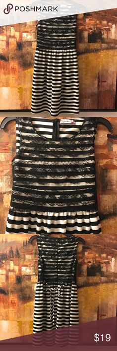 Girls black and white stripped dress New Size 8 girls adorable black and white stripped dress with lacy top. Below knees. Please let me know if measurement needed and will reply back . Thanks😃😊 Dresses Casual