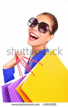 Shopping woman laughing. Excited girl walking looking back with her shopping bags on her shoulders. Isolated on white background. - stock photo