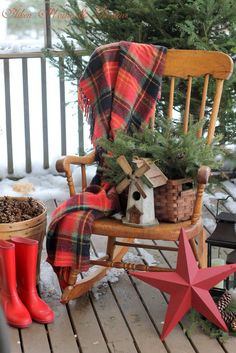Winter Porch love the basket with greens and windmill birdhouse on the chair.  Great use of red accents!