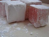 Turkish Delight, or lokum (also loukoum), is a confection made from starch and sugar. Turkish Delight, Yummy Treats, Sweet Treats, Yummy Food, Fun Desserts, Dessert Recipes, Walnut Recipes, Food Words, Turkish Recipes