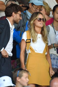 2015 Cressida Bonas wore a mustard yellow dungaree dress with a white T-shirt. - HarpersBAZAAR.co.uk
