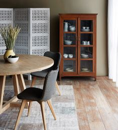 Contemporary & Farmhouse Inspired. Interior styling with Nomad India - White Screen & Rustic Brown Cabinet. Nomad Home - Cross Leg Round Dining Table. Vincent Sheppard - Joe Teak Leg Grey Wash Dinning Chairs. #Woody #Vintage