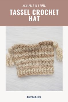 If you're looking for a quick project to use up that skein of Unforgettable in your stash, check this pattern out. Our tassel crochet baby hat works up in a matter of hours.  #BHooked #Crochet #FreeCrochetPattern