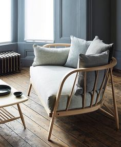 """291 Likes, 10 Comments - @ercol_uk on Instagram: """"The Nest sofa. Designed for ercol by Paola Navone. Solid steambent beech with a nest of cushions.…"""""""
