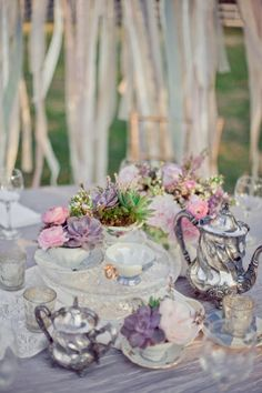 roses & succulents & moss in tea cups  with silver & lace