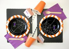 EEK!! Tabletop - Celebrate this Halloween with an EEK!! Spider party.  Bright, bold Halloween colors make this party fun and festive with cute spider napkins and dessert plate!  8 Chevron Orange Lunch Plate 8 Spider Web Dessert Plates 16 Spider Web Beverage Napkins 20 Purple Lunch Napkins 10 Orange 12oz Cups  10 Black Dot Paper Straws 10 Wooden Forks 8 Black Placemats