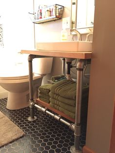 We repurposed butcher block countertops and paired it with galvanized pipe to create a one of a kind open vanity.