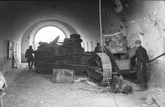 German soldiers inspecting two abandoned Polish tanks, Renault FT-17's.