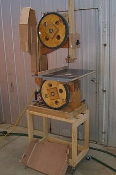 Wood Bandsaw by Canoath -- Homemade wood bandsaw constructed from oak, plywood, steel, bearings and hardware. Powered by a 1 HP 1400 RPM motor. http://www.homemadetools.net/homemade-wood-bandsaw-4