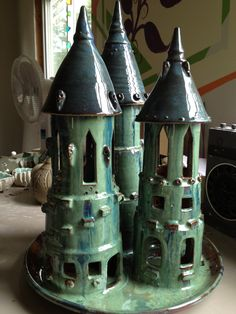 Triple turret castle.  Lovely in the home or patio