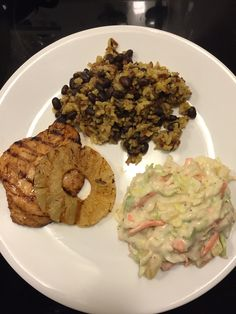 One of our favorites Caribbean marinade, grilled chicken,pineapple slices, curry rice with black beans,marinade pineapple coleslaw