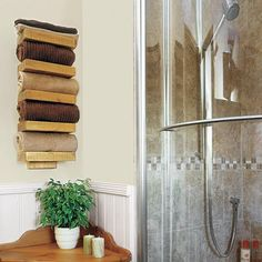 """towel """"rack"""" from wooden boards stained and fastened to wall"""