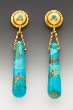 the silk road collection ::Beautiful specimens of Kingman turquoise in all its glory, made even more authentic looking with its complementary brown matrix. On 18K gold posts with bezel-set turquoise cabochons.