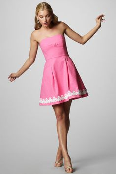 Strapless dress with full skirt and lace at hem.
