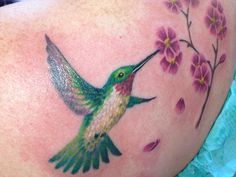 Hummingbird and flower tattoo by Abby Lusk of Diversified Ink in Bangor, Maine!