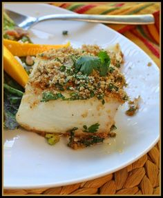 Cilantro Halibut modified - I used a much simpler preparation than the recipe calls for:    Create mixture of panko, italian bread crumbs, grated ginger, minced garlic, finely chopped cilantro, salt, pepper    Spread 2 tablespoons of oil over a foil-covered sheet pan and lay fish on top.     Press crumb mixture firmly over each fish fillet. Drizzle olive oil over the top, and dot the tops with butter.    Bake at 450 for 10-12 minutes, or until fish is flaky.    Fantastic!    Fantastic.