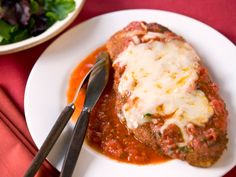 Chicken Parmesan : This chicken Parmesan is all about moderation: Saute the chicken in a little oil to get that characteristic crunch, then top with just enough cheese and lots of sauce.
