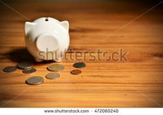 piggy bank with money on wood background. Concept save money.soft focus