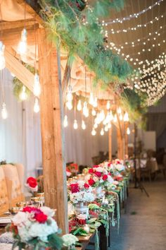 Winter #wedding reception decor - greenery + twinkle lights on ceilings with red rose + greenery centerpieces {Castleton Events: Design & Planning}