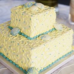 Two tier square cake with yellow and blue piping and shell accents. Photo by Marissa DeCinque. Cake by The Sweet Life Bakery. Sweet Life Bakery, Sea Cakes, Square Cakes, Wheat Belly, Occasion Cakes, No Bake Cake, Wedding Anniversary, Yellow, Blue