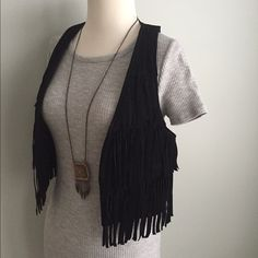 Black Suede Leather Fringe Vest LOVE this suede leather fringe vest--all black, fitted cut and great T back shape. This looks fantastic with your favorite jeans and biker boots, as well as to add to a bohemian maxi for extra oomph  Forever 21; NWOT. Never worn. Size Small. Forever 21 Tops