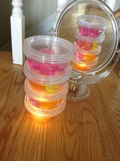 Plastic ice cubes, mirrors, containers and a mini light. @playing_in_k
