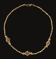 A GREEK GOLD AND GARNET NECKLACE                                                                                                                                                                       HELLENISTIC PERIOD, CIRCA 2ND CENTURY B.C.