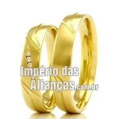 Alianças em ouro 18k Largura 5.4mm Pedras 5 diamantes de 1 ponto Acabamento Liso e Fosco Formato Anatômico Peso 8.5 gramas o par
