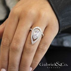 Gabriel NY - Preferred Fine Jewelry and Bridal Brand. Daring and modern, this pear cut engagement ring features two scintillating diamond halos with an exaggerated silhouette and a contoured pave diamo Double Halo Engagement Ring, Pear Shaped Engagement Rings, Engagement Ring Shapes, Diamond Engagement Rings, Pear Shaped Rings, Engagement Bands, Diamond Bands, Diamond Jewelry, Halo Diamond