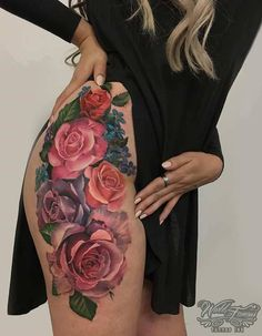 15 Bad-Ass Thigh Tattoo Ideas for Women: #6. COLORFUL FLOWER DESIGN