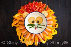 Kids will have a roaring good time with this Simba veggie tray with ranch dip and free Lion King printable activity sheets!