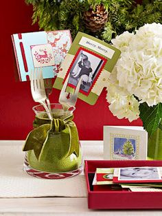 Great centerpiece idea - forks in a jar to hold photos.