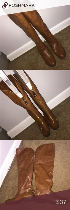 Over the knee cognac boots sz 7 Over the knee cognac boots sz 7. Super high boots goes well over jeans. Natural color matches with everything. Making space in closet. Super fuzzy inside to keep warm. Gold zipper and gold buckle on the outside of boots. I can send more pictures if needed! Can be worn over the knee or fold tops with large cuff to just the knee - your choice! bamboo Shoes Over the Knee Boots