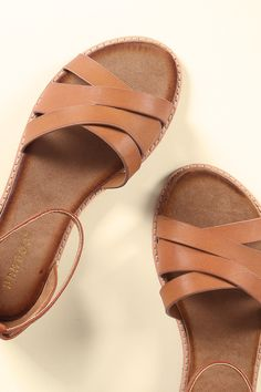 This adorable flat sandal features a strappy construction, open toe silhouette, adjustable buckled ankle strap, and lightly padded insole for comfort. Material: