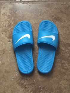 NIKE vivid blue Benassi slides