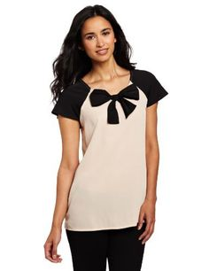 Coupe Collection Women's Hillary Blouse Coupe Collection. $16.74. The blouse has a regular fit and has the label on the back neck. polyester. Machine Wash. The blouse has a non-functional black bow at the front with color blocked sleeves and has short sleeves