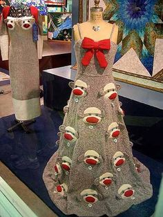 "Interested in an unusual prom dress?  How about this whimsical ""Un-Prom"" gown designed by Minneapolis-based designer Rebecca Yaker?  Created on a knitting machine, it's fully lined in red satin and studded with 30 sock monkey faces, all with their own personal name tag.  Price?  $1,500."