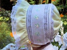 100% cotton batiste fabric * Front ruffle * Swiss embroideries Silk ribbons * Mother-of-pearl buttons * Adjustable back ribbon casing Choose White or Ecru Lace Hand made in the USA at the time of your order.