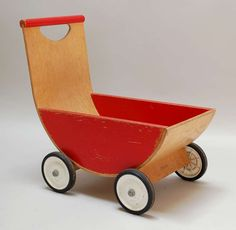 """21"""" painted and molded plywood Carriage push toy, United States, 1960, by Creative Playthings."""