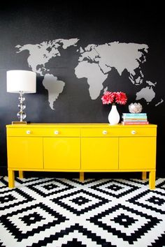 Loving when old furniture gets an updated with a bold coat of paint! Yellow cabinet, black feature wall, interior decor design