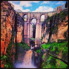 """The Puerta Nuevo or """"New Bridge"""" in Ronda, Spain - with a 100m descent into the chasm and raging torrent below #travel #europe #spain #andalucia #bridge #river #gorge #nature Photo by shinyshoestring"""