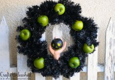 Directions for making your very own Poison Apple Halloween Wreath.  Love this!