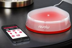The Revolv Smart Home Automation Solution is a central hub that connects many smart home devices such as Philips Hue lights, Yale locks, Sonos Hi-Fi speakers, and Insteon sensors. GetdatGadget.com