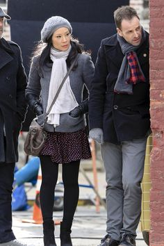 Jonny Lee Miller and his co-star sidekick Lucy Liu snoop around during a scene for their show 'Elementary,' in New York City.