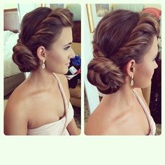 in love with this twisted low bridal updo!