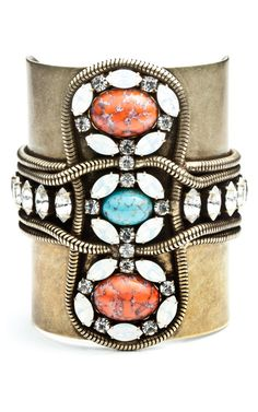 antiqued brass cuff with snake chain detailing and clear and opal Swarovski crystals surrounding turquoise and coral resin stones; Daniela Cuff by Dannijo